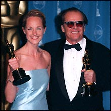 With Jack Nicholson, holding their Oscars